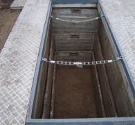 Een graf wat klaar ligt voor begrafenis